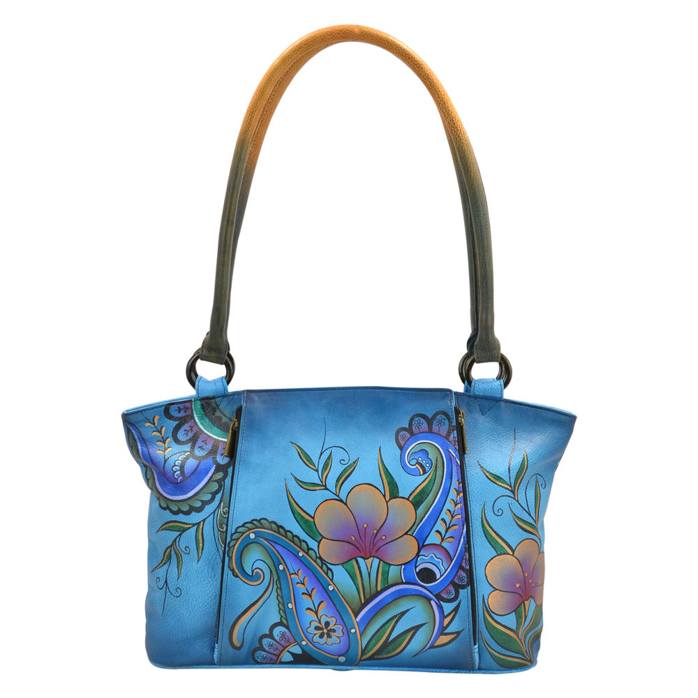 *Genuine hand-painted leather *Top zip entry to large roomy compartment *Zip-down organizer compartment with a magnetic snap closure in front *Rear has a zippered pocket and slip-in cell pocket *13.25\\\