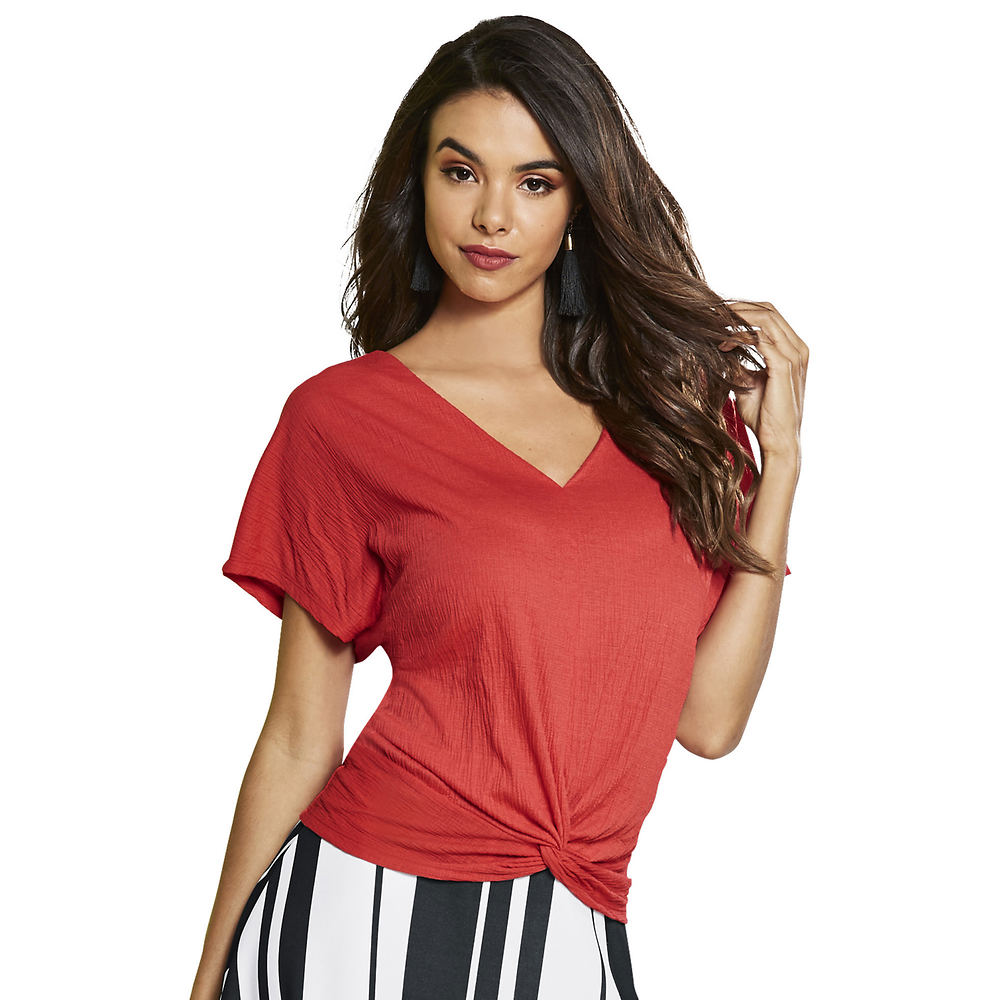 *Put a twist on a summer staple with the versatile V-neck top with stylish knotted front *Poly/spandex *Machine wash *Import