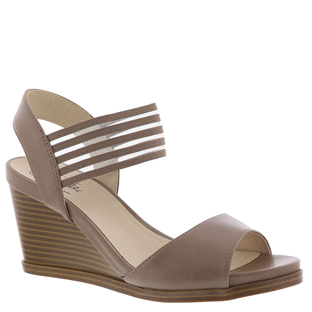 *Get cruise ready with this modern wedge sandal *Faux leather upper with striped stretch gore panel for flexibility *Easy slip-on styling *Life Stride® Soft System® comfort system for all-day flex support and cushioning *2-1/2\\\