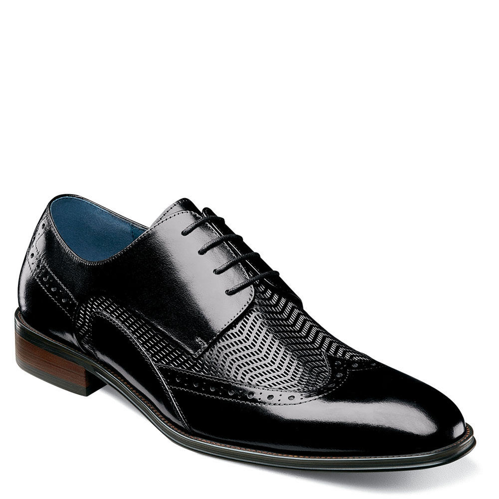 *Heighten the level of sophistication in your attire with the sleek details of this dress wingtip oxford *Embossed buffalo leather upper with wingtip detailing *Lace-up closure *Leather lining *Lightly cushioned footbed *Non-leather outsole