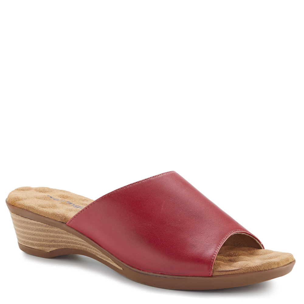 *Step up your casual looks with this effortlessly chic and comfy slide *Leather upper with elastic gore *Slip-on styling *Lightly cushioned footbed *1-1/2\\\