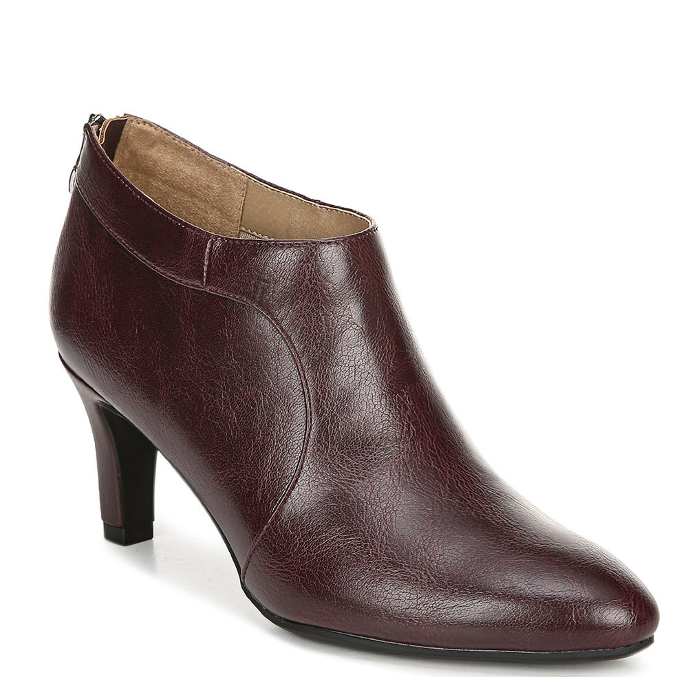 *Add a chic feel to your work-to-weekend looks with this sleek bootie *Faux leather upper *Back zipper closure *Soft System® comfort package offers all-day support flex and cushioning *Traction sole provides extra stability *2-3/4\\\