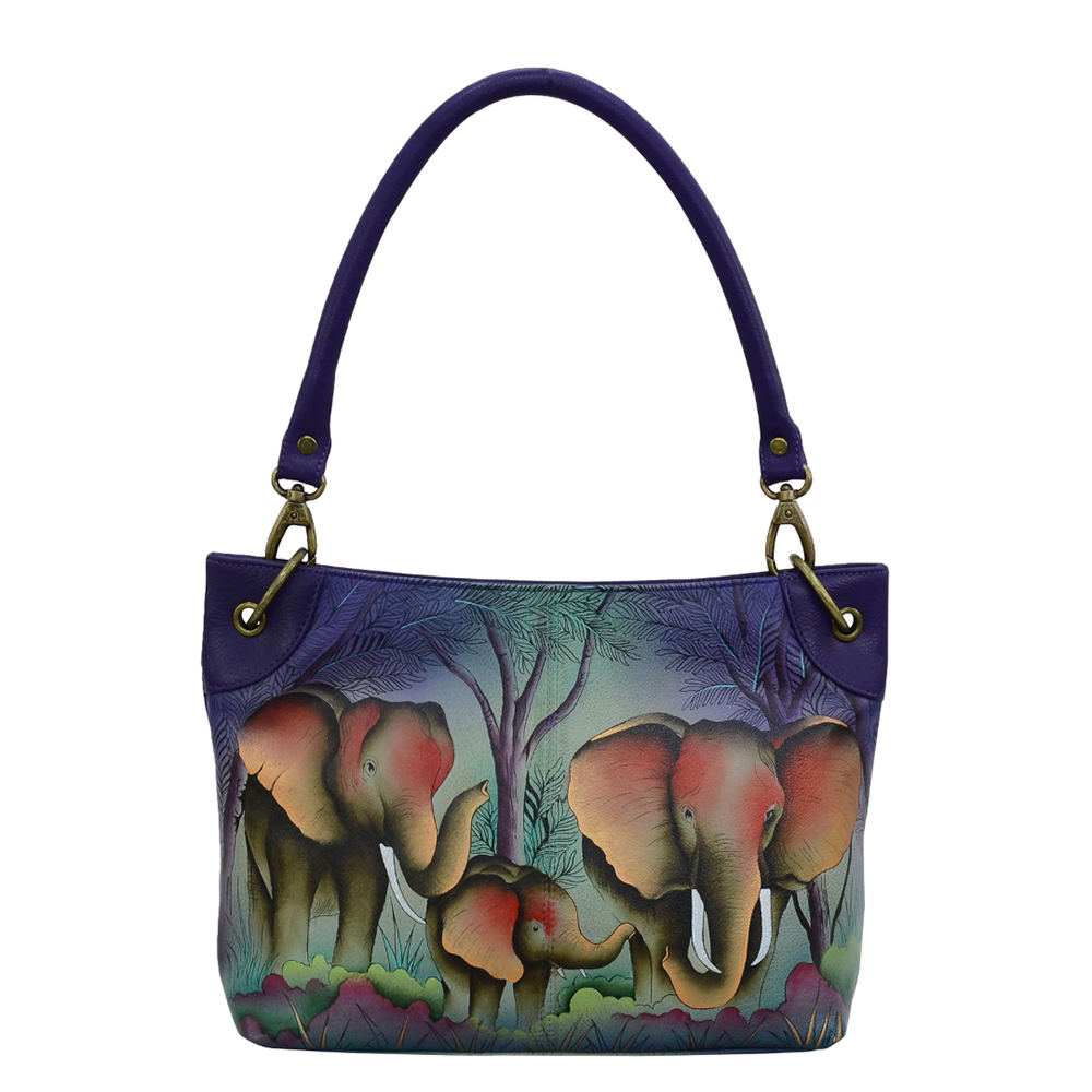 *Stylish and versatile keep essentials close at hand with the sleek Anna by Anuschka Leather Crossbody Hobo *Hand-painted leather material *Magnetic snap entry *Rear full-length zippered pocket and slip-in cell pocket *Interior zippered compartment open wall pocket and 2 multipurpose pockets with gusset *Removable shoulder strap with 9.5\\\