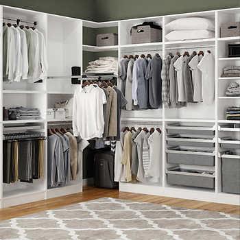 Custom assembled closets by technik cabinetry system for Closets modernos para parejas
