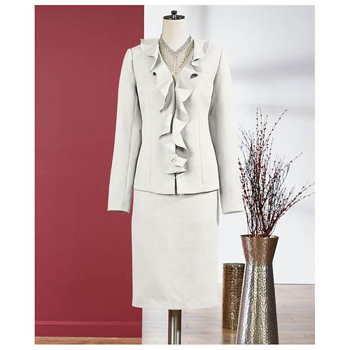 My favorite top to wear under a suit jacket is a silk blend knit, square neck, short sleeve top from Tahari at Macy's. I bought it for $30 or so, and I see versions of if all the time in the suit .