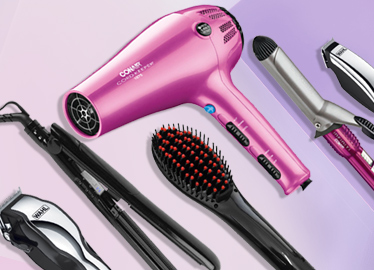 Pirture of hair dryer, brushes and hair tools.