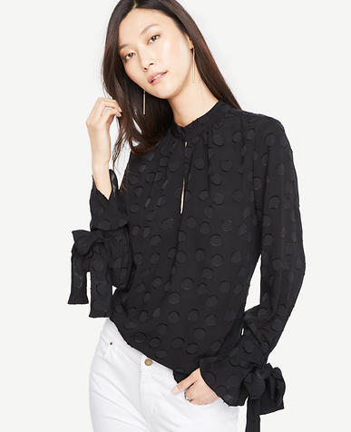 Image of Clip Dot Jacquard Bow Cuff Blouse